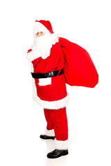 Full length Santa Claus with sack full of presents