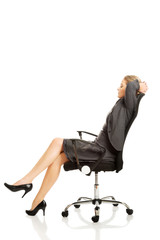 Businesswoman resting on armchair