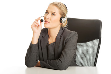 Call center woman sitting at the desk