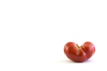 tomato in heart shape on white background, spacing, caption