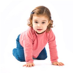 Little girl crawling over white background
