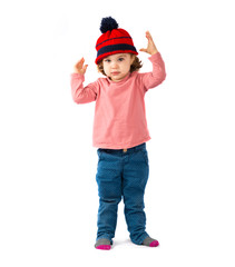 Little girl putting on a Christmas hat over white background