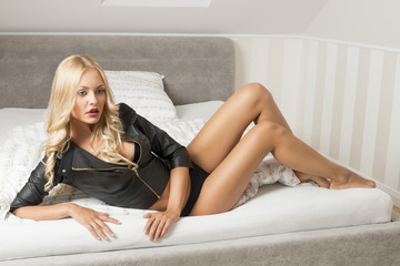 glamour woman posing on bed