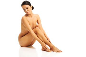 Full length photo of nude woman sitting