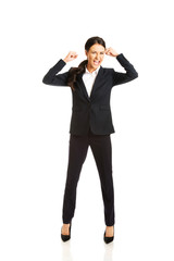 Full length angry businesswoman making fists