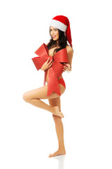Santa woman standing with bended knee