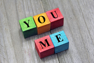 you and me words on colorful wooden cubes, concept of dating