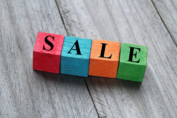 sale concept on colorful wooden cubes