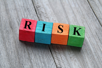 concept of risk on colorful wooden cubes