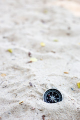 compass on the sea sand