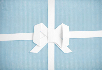 Blue vintage paper with a white ribbon and bow