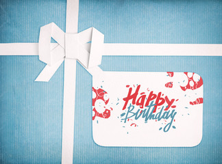 Gift ribbon and bow with Happy birthday lettering on gift tag