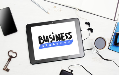"Business strategy. Digital tablet with ""Business strategy"" lette"