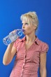canvas print picture - Blond woman drinking water