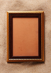 Gold frame on sand