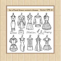 Vector set of hand drawn women's dresses on hangers