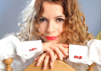 Young woman in white shirt with red racing car cufflinks