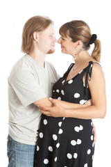 young happy pregnant woman and her husband