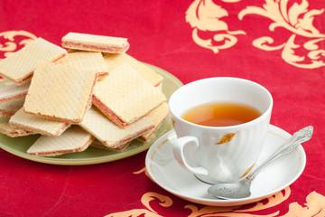 cap of tea and waffles
