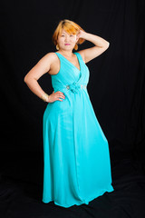 portrait of blonde young woman wearing a blue long dress