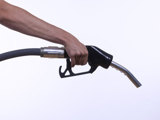 Hand holding a gas pump, isolated on white background