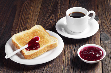 Toast with jam and coffee