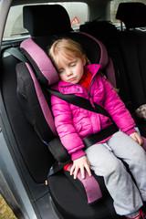 little girl in a car seat
