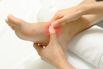 Doctor examining an injured foot,sport injury