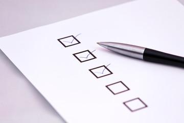 Checklist with a pen.
