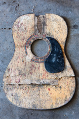 Broken acoustic guitar