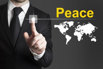 businessman pushing button peace world