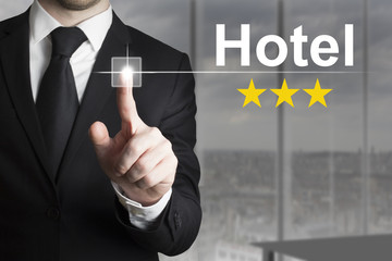 businessman pushing button hotel three stars