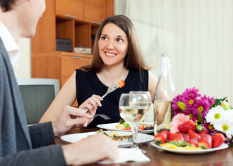Young couple having romantic dinner with champagne