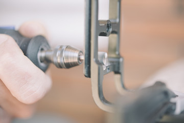 using a rotary tool to cut a new slot in a wood screw