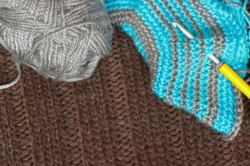 Gray silky yarn with striped crochet hook
