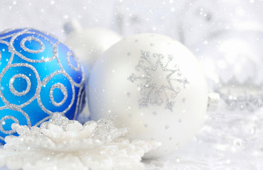 Christmas silver and blue decorations on festive background