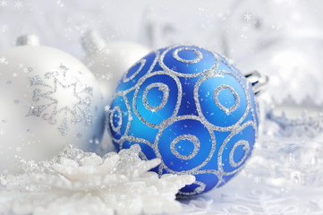 Christmas blue and silver decorations on festive background