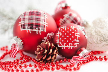 Closeup of red Christmas balls on festive background