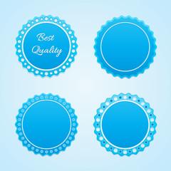 Decorative badges in a patterned design.