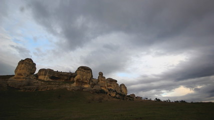 clouds running above stone rocks