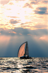 Sports yacht in the sea at sunset.