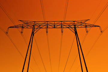 high voltage pylon silhouette at dusk light