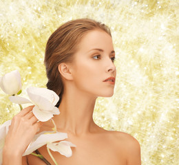beautiful young woman with orchid flowers
