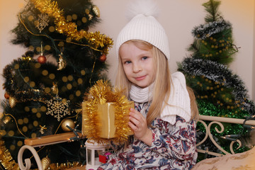 Girl with Christmas golden gift