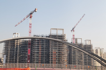 Construction site with building cranes and blue sky