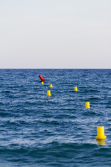 Yellow buoys in the sea