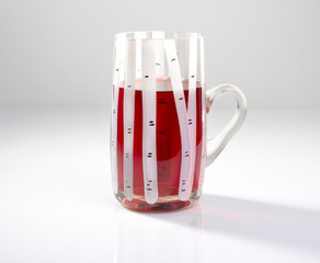cranberry drink in a mug on a gray background