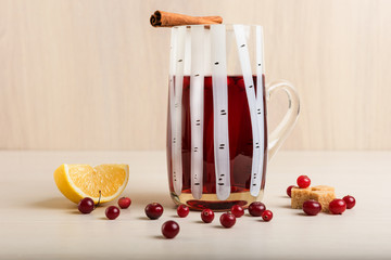 cranberry juice with lemon and cinnamon in a mug