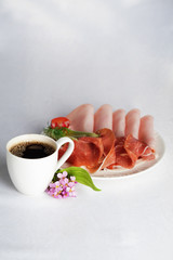 coffee cups and plates with threaded ham