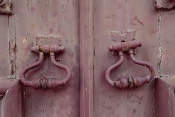 Fragment of old wooden door with metal knob